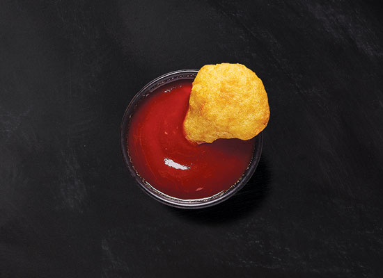 Cheesy brew bites dipped in ketchup